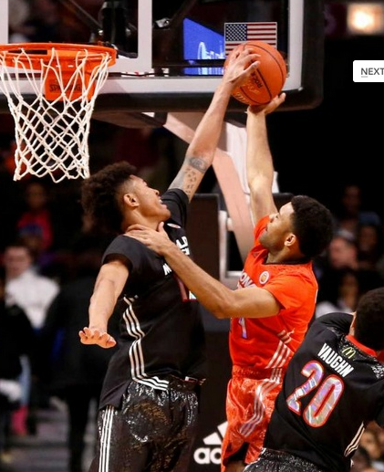 Photo: AP. McDonald's West All-American Kelly Oubre, left, a Kansas signee, blocks the shot of McDonald's East All-American James Blackmon Jr., during the first half of the McDonald's All-American boy's basketball game Wednesday in Chicago.